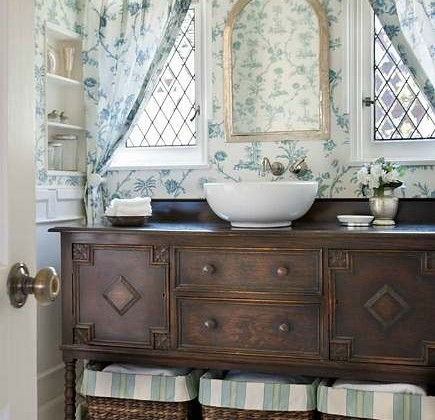 sideboard vanity - antique Jacobean sideboard made into a bathroom vanity with bowl shaped vessel sink - 305sealanelajolla.com via atticmag
