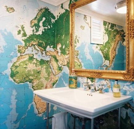console sink - bathroom with map of the world wallpaper and Kohler Memoirs console sink - Lonnymag via Atticmag