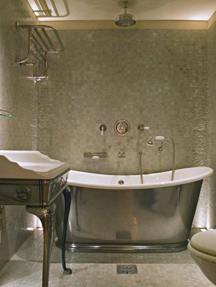 silver bathtub - slipper tub with matching console sink in a Max Rollitt bathroom via Atticmag
