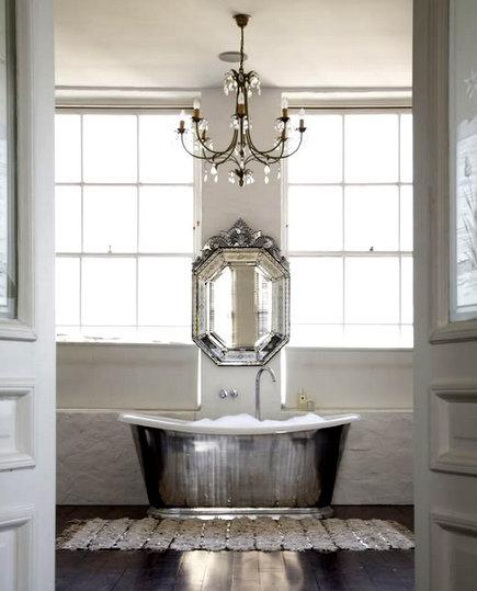 silver bathtub - slipper tub with Venetian mirror mounted above it in a showhouse bathroom - arianabelle.com via Atticmag