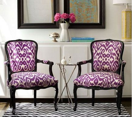 purple chairs - French armchairs with purple ikat print upholstery and black frames - Diane Bergeron via Atticmag