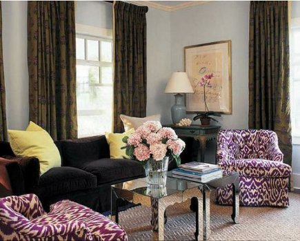 purple chairs - arm chairs coompletely upholstered in purple and white ikat fabric - Michael Penney Style via Atticmag