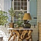 entrance decor - gnarled wood table and lamp front porch by Steven Gambrel via Atticmag