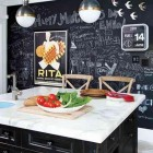chalkboard paint kitchen walls - black and white kitchen with full blackboard painted wall - Pinterest via Atticmag