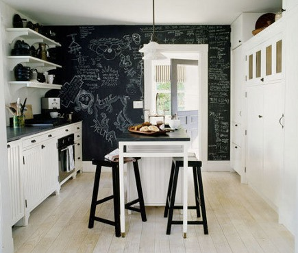 chalkboard paint kitchen walls - black and white kitchen with black accent chalkboard painted wall - Apartment Therapy via Atticmag