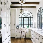kitchen cabinet hardware - black hardware matching steel-palladian windows in a white cabinet kitchen - pinkwallpaper via Atticmag