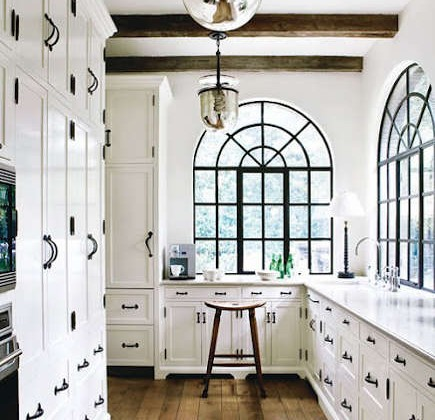 kitchen cabinet hardware - black hardware matching steel-palladian windows in a white cabinet kitchen - pinkwallpaper via Atticmag