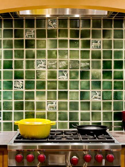 yellow farmhouse kitchen with pine-green tiled range niche - Smith and Vansant via Atticmag