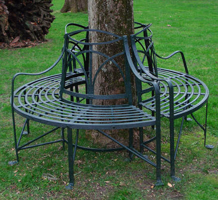 round tree bench - antique wrought-iron English semicircular garden seats from Barbara Israel via Atticmag
