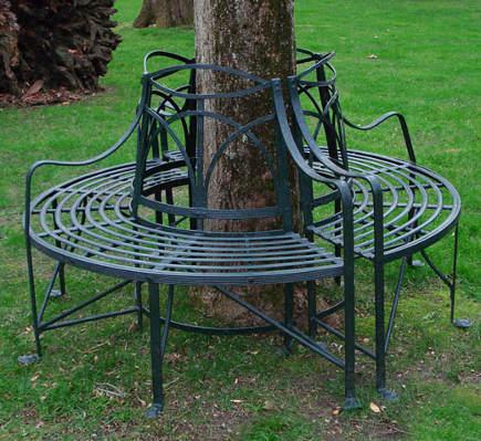 round tree bench - antique wrought-iron English semicircular garden seats from Barbara Israel via Atticmag