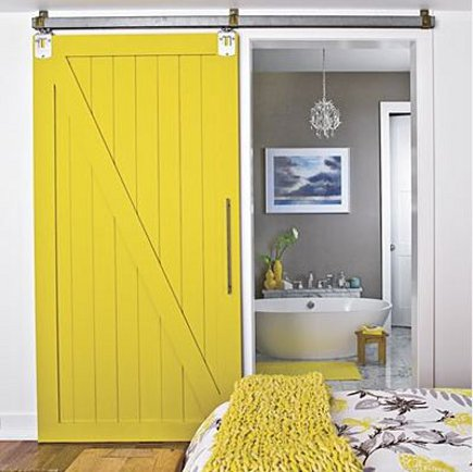 Yellow barn interior barn door with slash motif and batten background - cozybliss via Atticmag