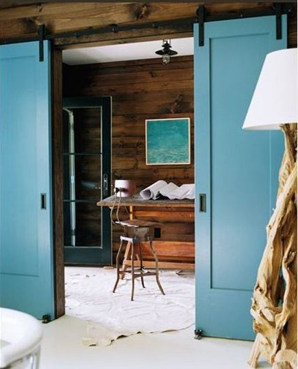 interior barn door - pair of Shaker panel style teal blue sliders with finger pulls - Apartment Therapy via Atticmag