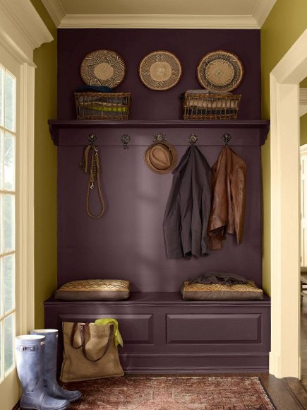 plum purple - mudroom hanging space painted muted dark purple - Laura Casey Interiors via Atticmag