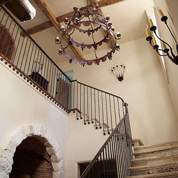 foyer with decorative wrought iron railing staircase from House Beautiful