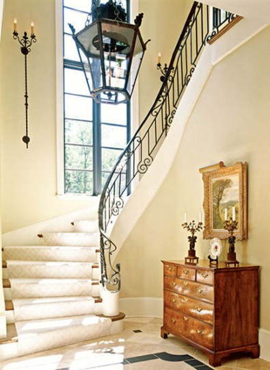foyer with decorating wrought iron railing from Traditional Home