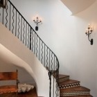wrought iron railing - staircase by Thomas Thaddeus Truett - via Atticmag