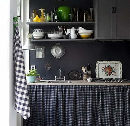 black and white tile - black and white patterned kitchen with unique tile floor, gray cabinets and open shelves with a skirted sink base - Foxtrotter via Atticmag