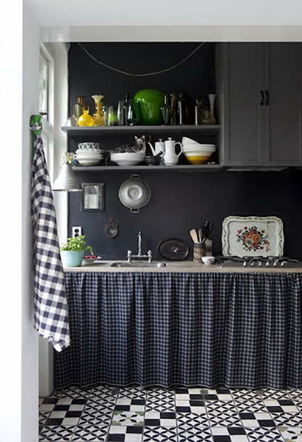 black and white tile gray cabinets and open shelves with a skirted sink base kitchen - Foxtrotter via Atticmag