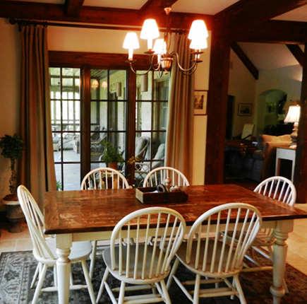 breakfast room with Restoration Hardware Belgian linen curtains - atticmag