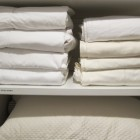 laundry soap test - freshly laundered cotton sheets in my linen closet - Atticmag