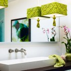 green bathroom accents - acid green pendant light used as accent - Sunset Magazine via Atticmag