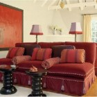 banquette sofas - red velvet banquette sofa with cording and tassels - Antonia Hutt via Atticmag