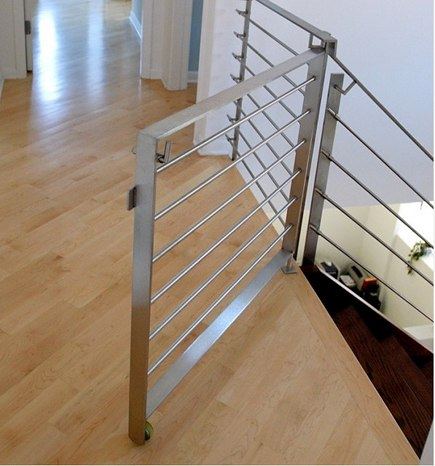 stairway gates - custom modern staircase gate with horizontal bars and a wheel - MILKdesign via Atticmag