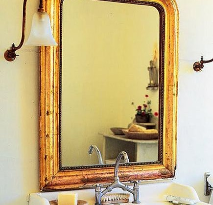 gold leaf mirrors - gold leaf French bathroom mirror - Heide Claire via Atticmag