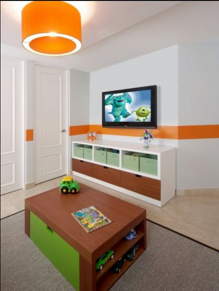 toddler's room- mid-20th century style kids room with flat screen TV above a storage credenza - Kleppinger Design Group via Atticmag