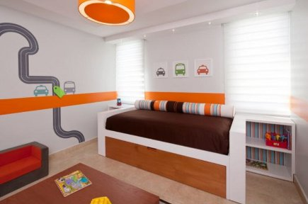mid-20th century style kids room with colorful wall graphics and built in trundle bed