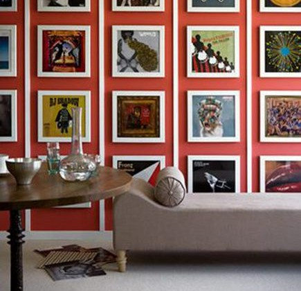 picture walls - 3D picture wall with vertical molding strips between rows of framed pictures - paul raeside via Atticmag