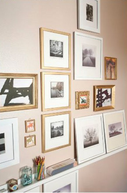 picture wall s- picture wall with frame pictures hung on a beige wall and other pictures displayed on a shallow shelf rail - domicile id via Atticmag