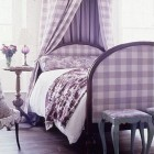 lavender bedrooms - bedroom with lavender check upholstered bed and canopy and lavender toile prints throw and bed roll - Southern Accents via Atticmag