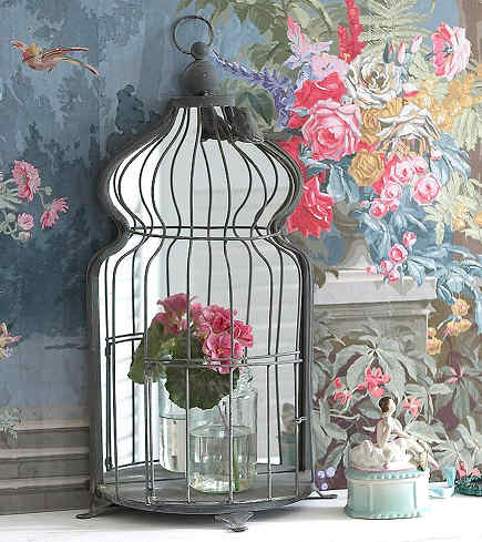birdcage motif - demi-lune shape mirror backed bird cage cabinet - An Angel at My Table via Atticmag