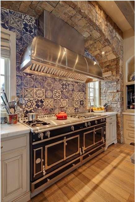 restaurant ranges - black La Cornue Grand Palais 180 series range with blue and white tile backsplash - dj architects via Atticmag