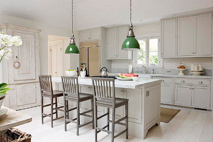 kitchen stool style - Bar height Swedish neoclassical style gray bar stools in a white kitchen - house beautiful via atticmag
