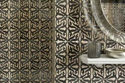 Moroccan tile bath detail with white porcelain shelf and mirror above the sink - Hotel Nord-Pinus, Tangier via Atticmag