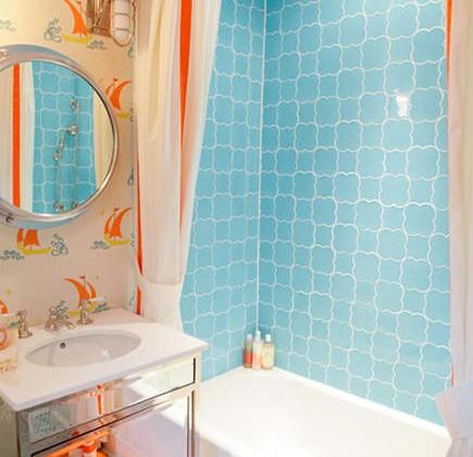 colorful orange and blue guest bath by Bailey McCarthy - Design Sponge via Atticmag