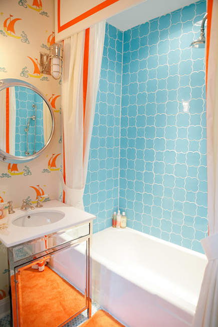 colorful orange and blue guest bath by Bailey McCarthy - Design Sponge via Atticmag