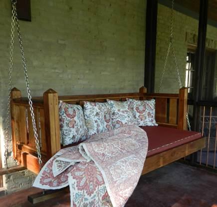 Allison's custom salvaged pine swinging porch bed - Atticmag