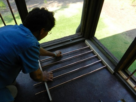 replacing Allison's porch spindles with copper rods - Atticmag