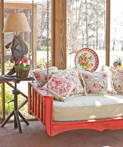 red painted custom swinging porch bed with mattress ticking cover and Crate & Barrel floral cushions - Country Living via Atticmag