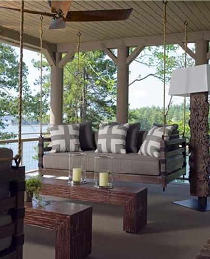 swinging porch beds - custom swinging porch bed with taupe and white geometric pillows - Atlanta Homes and Lifestyles via Atticmag