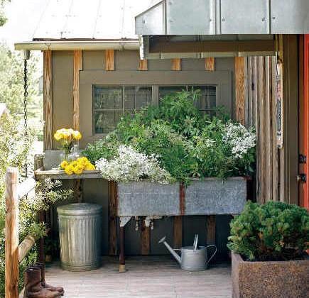 outdoor potting sink double bowl galvanized steel potting sink installed on a deck - atlanta homes magazine via atticmag
