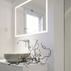 bathroom task lighting - contemporary white Danish bathroom with illuminated frame mirror over the sink - Norm.Architects.Copenhagen via Atticmag