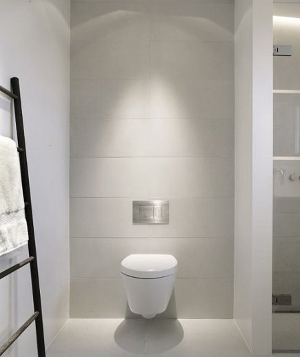 bathroom task lighting - lighted wall-hung commode in modern Danish bathroom - Norm.Architects.Copenhagen via Atticmag