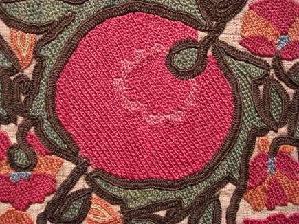 suzani textiles - detail of an antique suzani embroidered textile at a Sotheby's auction - Atticmag