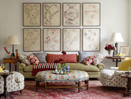 suzani textiles - living room with suzani-upholstered ottoman - House Beautiful via Atticmag