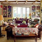 suzani textiles - antique suzani on the back of a living room sofa - Architectural Digest via Atticmag