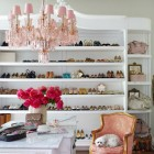 shoe closet - storage in an expanded armoire built in and painted white - House Beautiful via Atticmag